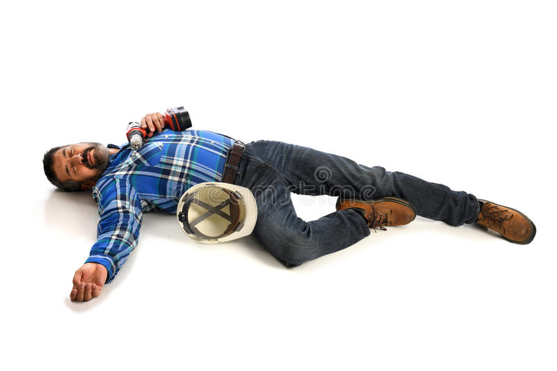 Worker Laying Injured. Hispanic worker laying injured on floor isolated over white background royalty free stock images