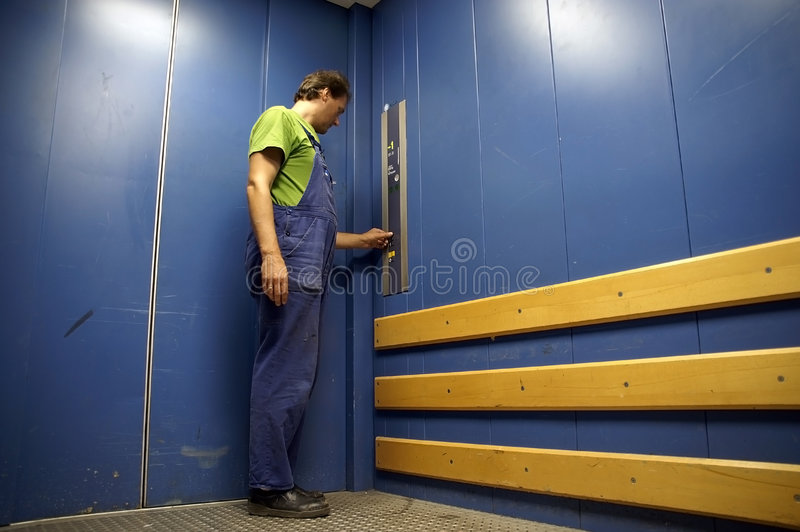 Download Worker In Lift 3 Stock Photo - Image: 1050780