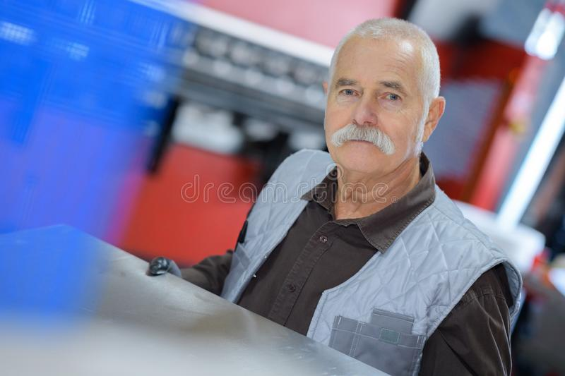 Worker looking at camera in warehouse royalty free stock photo