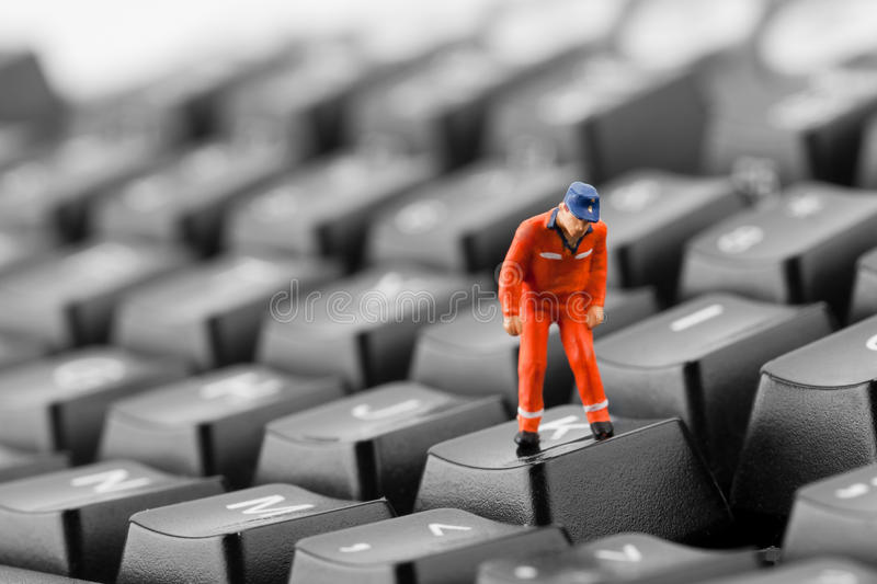 Worker looking into pit in keyboard stock images