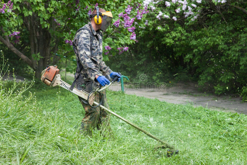 Worker in M.M. Gryshko National Botanical Garden (Kiev, Ukraine). stock photos