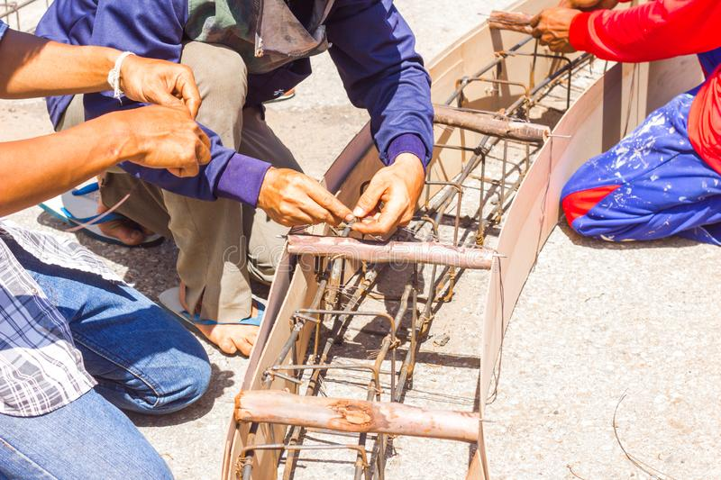 Worker make formwork in site constroction ,workers column box preparation for cement in roundabout construction royalty free stock photo