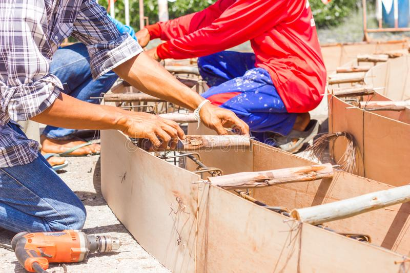 Worker make formwork in site constroction ,workers column box preparation for cement in roundabout construction royalty free stock photos