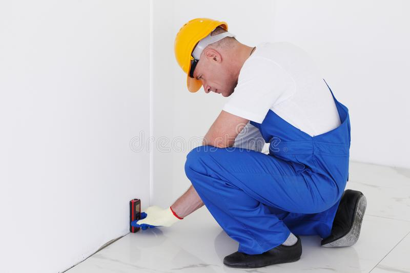 Worker using laser line level stock photo