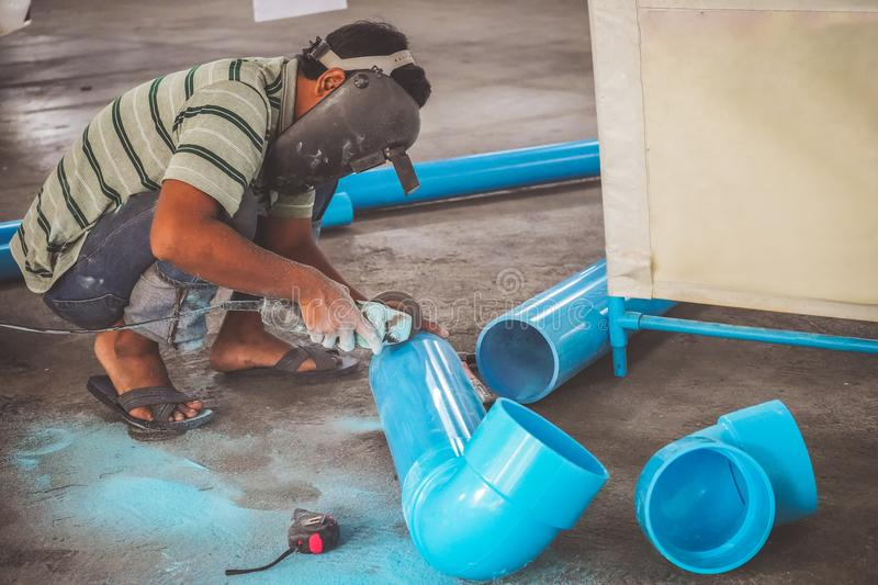 Download Worker Man Cutting PVC Pipe With Grinding Machine  Editorial Photo - Image of house & Worker Man Cutting PVC Pipe With Grinding Machine  Editorial Photo ...
