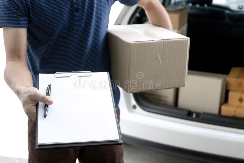 Worker man delivery the boxs to  home. Or office and send cardboard paper for sign, service, woman, parcel, vehicle, young, asian, post, mail, courier, package royalty free stock photos