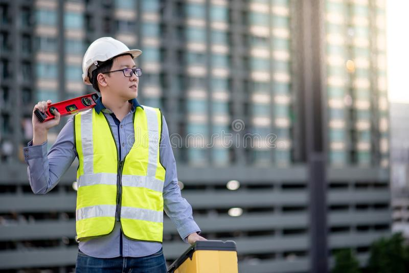 Worker man holding spirit level tool and box royalty free stock images