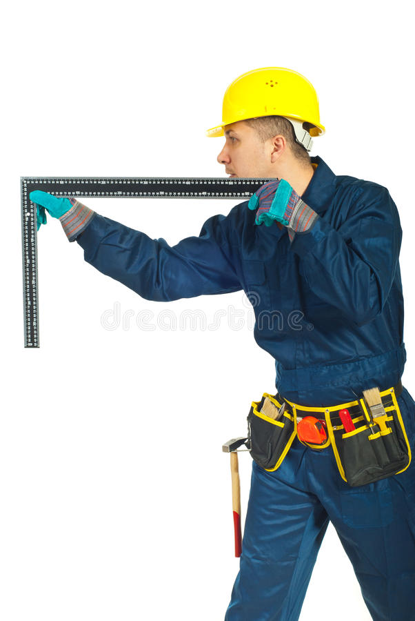 Worker man measure with L square ruler royalty free stock images