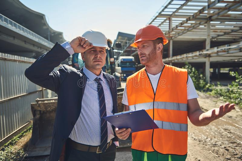 Worker man is speacking with his boss stock images