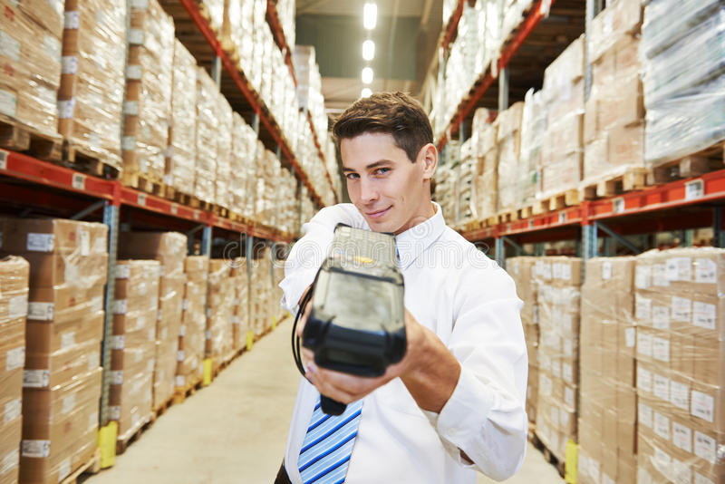 Worker man with warehouse barcode scanner royalty free stock photos
