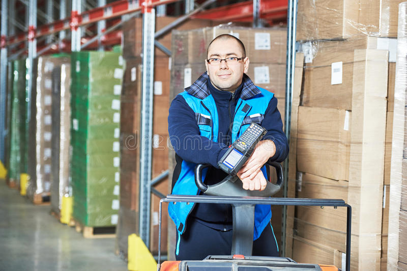 Worker man with warehouse barcode scanner. Male worker with barcode scanner in modern warehouse stock images