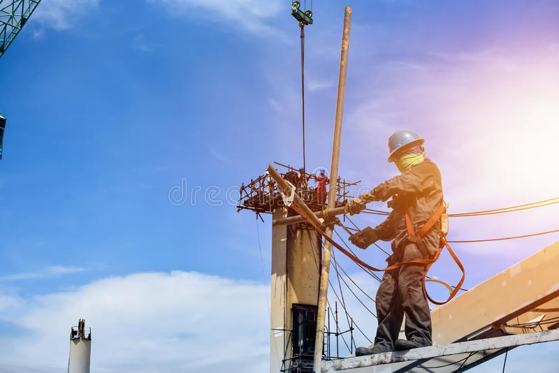 Worker man wearing safety harness and protective equipment PPE. royalty free stock photos