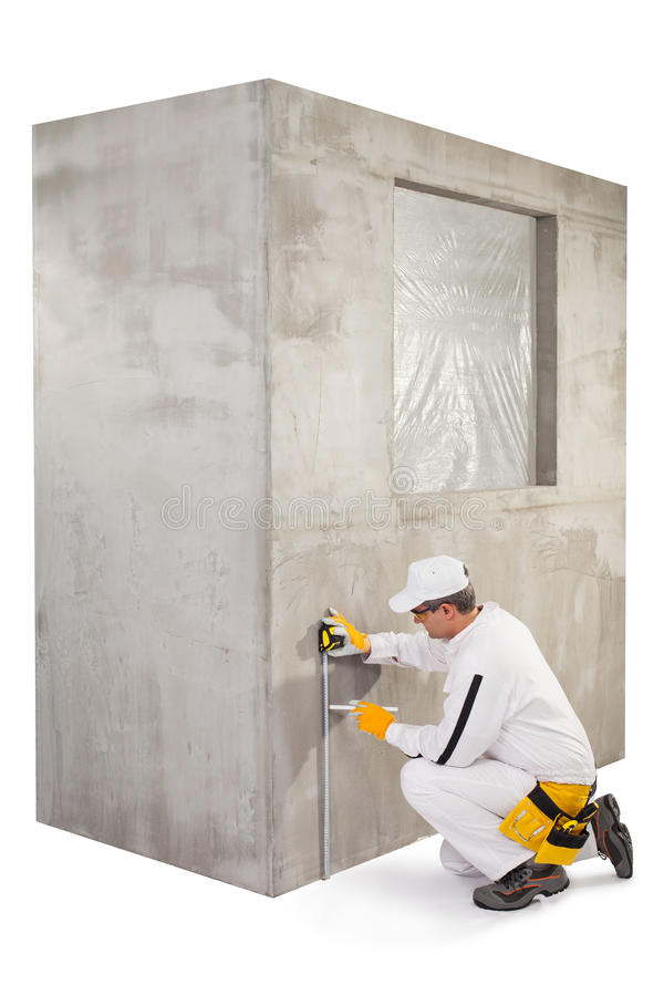 Worker Measuring The Level With Tape Royalty Free Stock Images