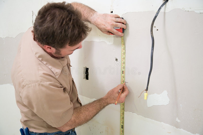 Worker Measuring and Marking stock images
