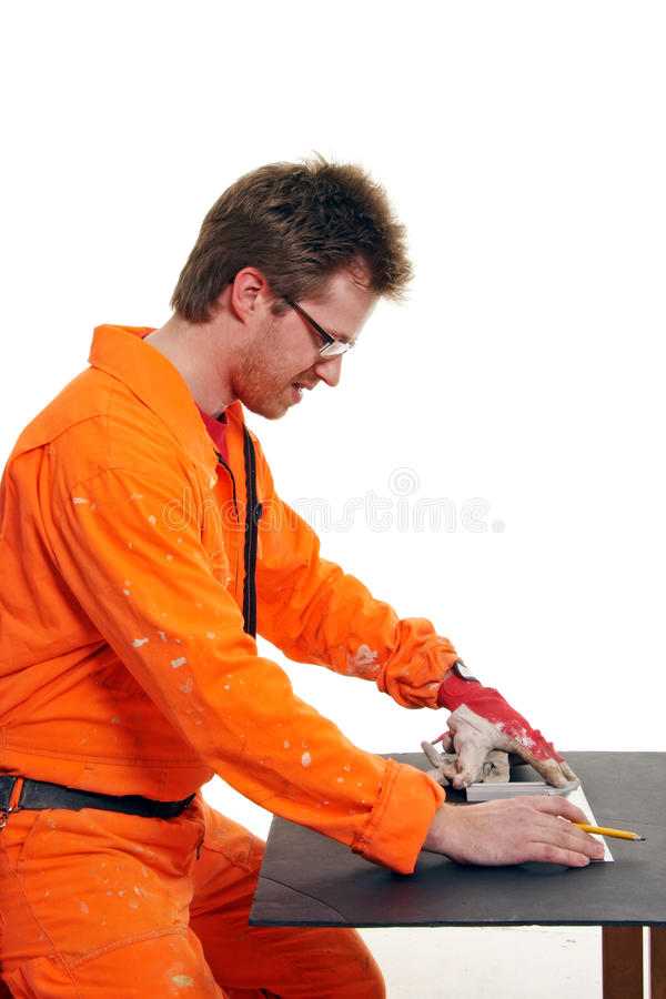 Worker measuring with a ruler royalty free stock photography