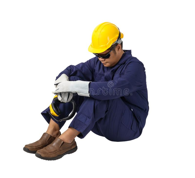 worker in Mechanic Jumpsuit is Sitting isolated on white background royalty free stock photos