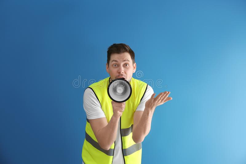 Worker with megaphone. On color background royalty free stock images