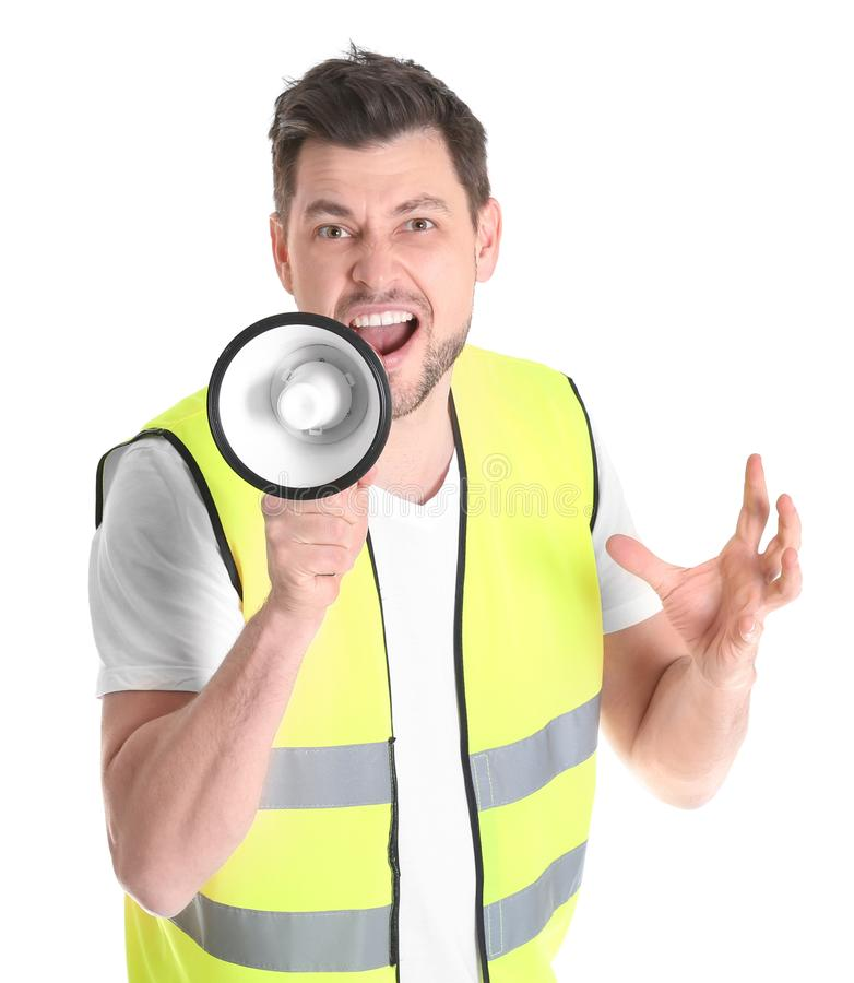 Worker with megaphone. On white background royalty free stock photo