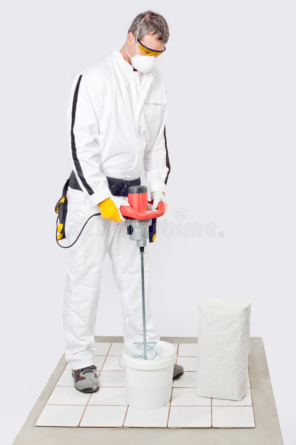 Download Worker Mix Cement Tile Adhesive Royalty Free Stock Photo - Image: 26949665