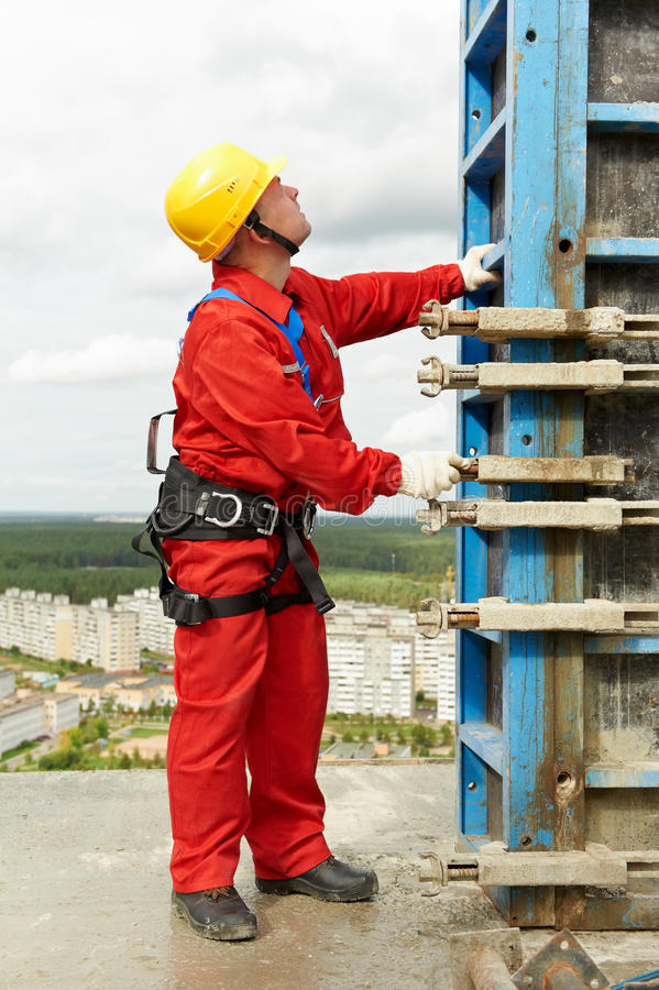 Worker mounter at construction site stock image