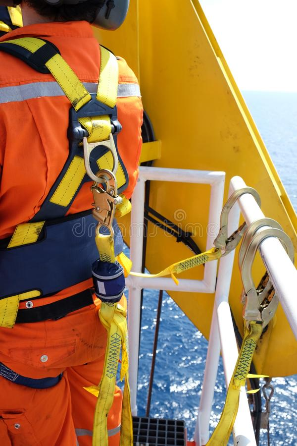 Worker at offshore with safety harness. stock photos