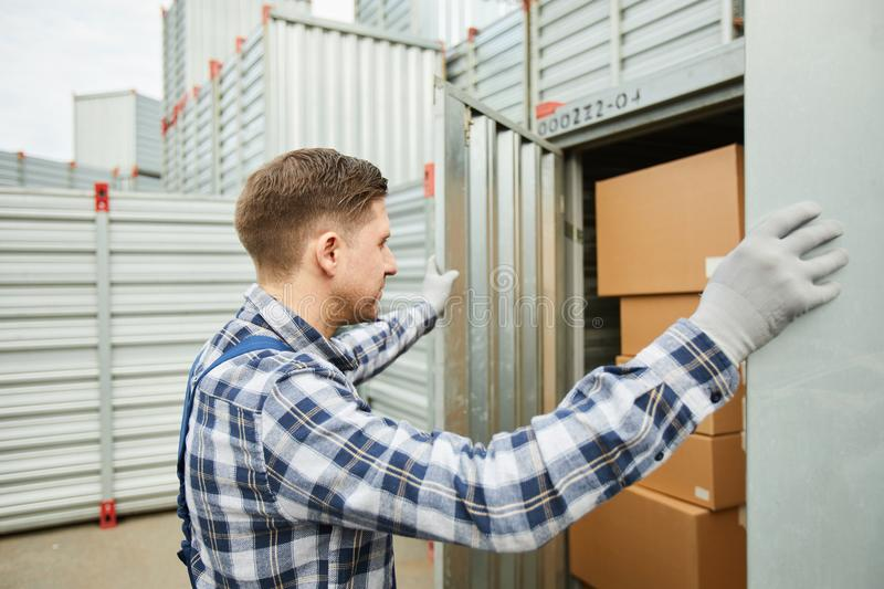 Worker opening cargo container stock image