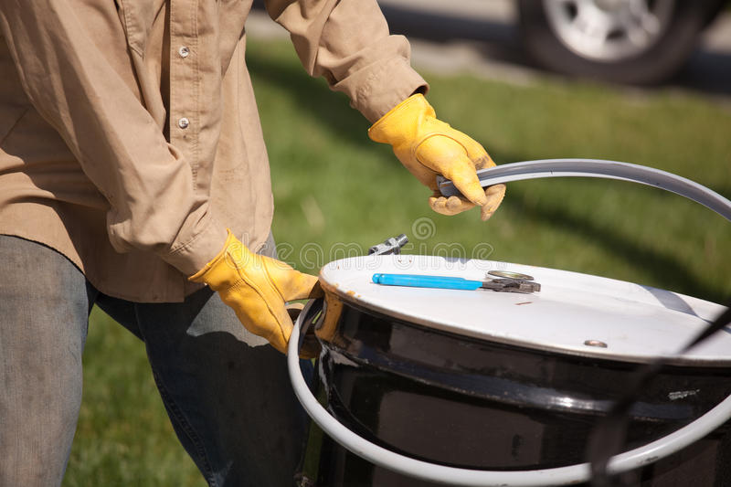 Worker Opening Or Sealing Utility Drum Royalty Free Stock Photos