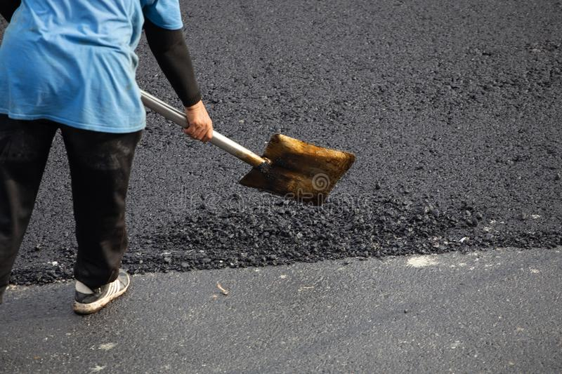 Worker operating asphalt road city,Construction work for a road and highway repair,Concept: Transportation symbol for vehicle. Worker operating asphalt road city royalty free stock images