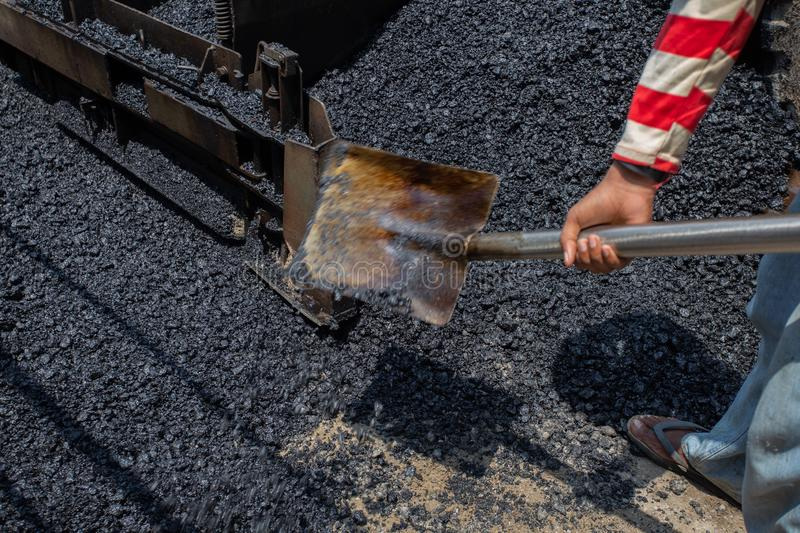 Worker operating asphalt road city,Construction work for a road and highway repair,Concept: Transportation symbol for vehicle. Worker operating asphalt road city royalty free stock photos