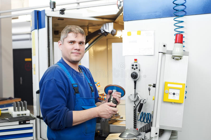 Download Worker Operating CNC Machine Center Stock Photo - Image: 20304230