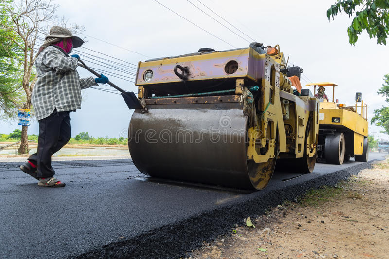download worker operating industrial asphalt paver machine during highway construction stock image image of machinery