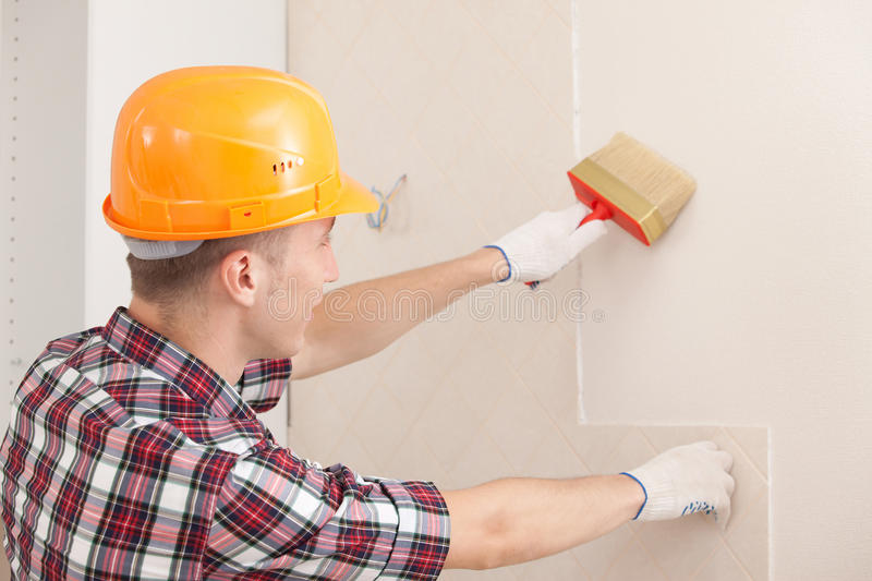 Worker with paint brush stock images