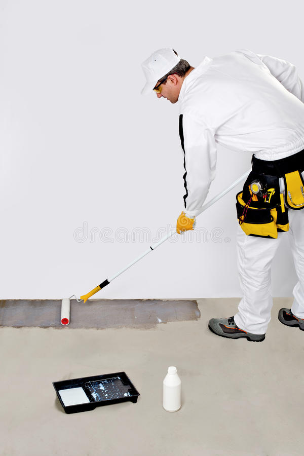 Download Worker Paint With Primer Concrete Stock Photos - Image: 26949693