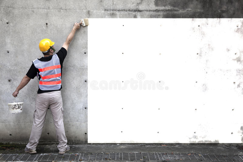 Worker painting the old wall royalty free stock photography