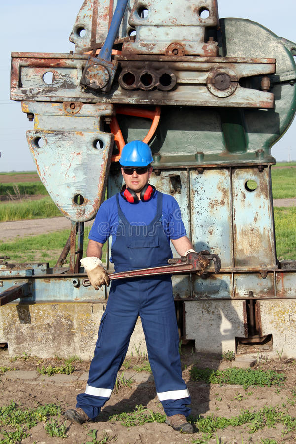 Worker with pipe wrench royalty free stock photos