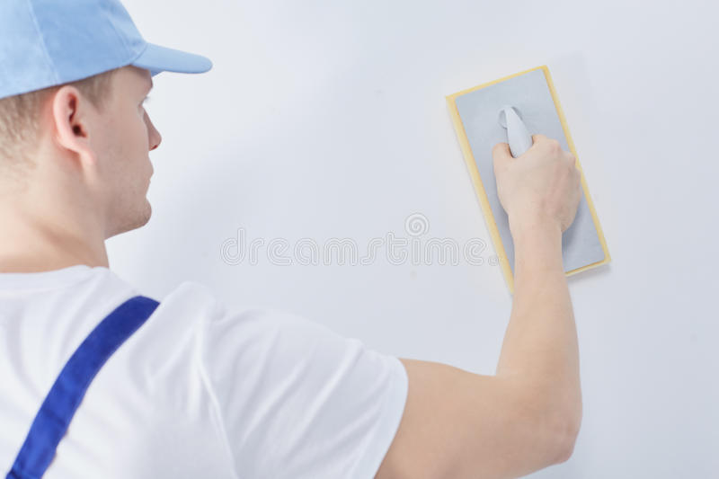 Worker with plastering trowel stock photo