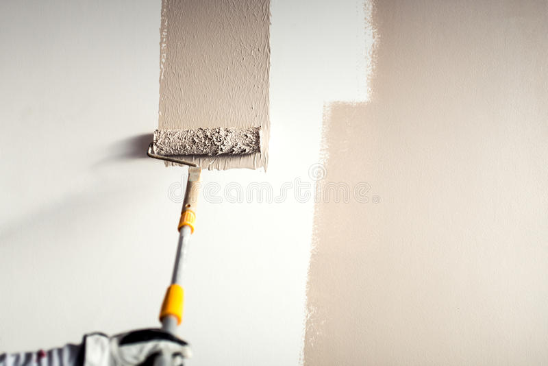 Download Worker Plastering A Wall, Painting With Paint Brush Decoration On  Interior Walls Stock Photo