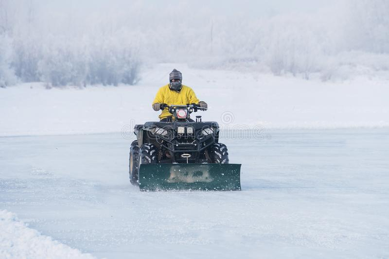 a worker plows heavy white snow during a Michigan winter stock photos