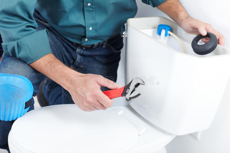 The worker with a plunger. Plumber with a toilet plunger. The worker royalty free stock photo