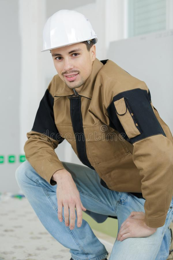 Worker posing and smiling royalty free stock image