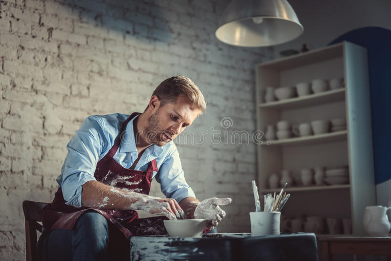 Worker in pottery stock image