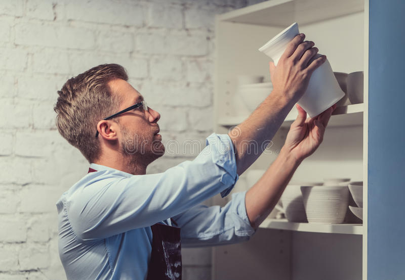 Worker in pottery royalty free stock photography