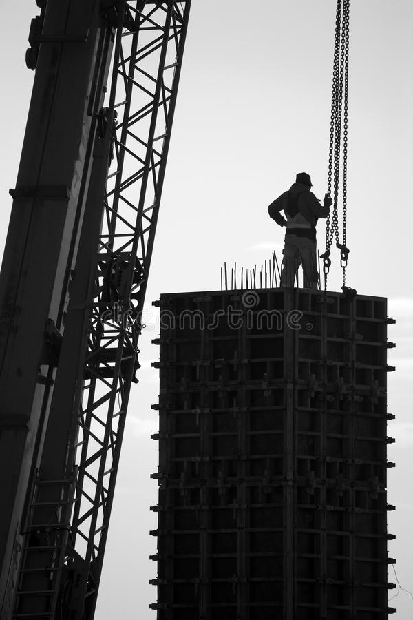Worker pouring cement. Photograph of the worker pouring cement royalty free stock photos