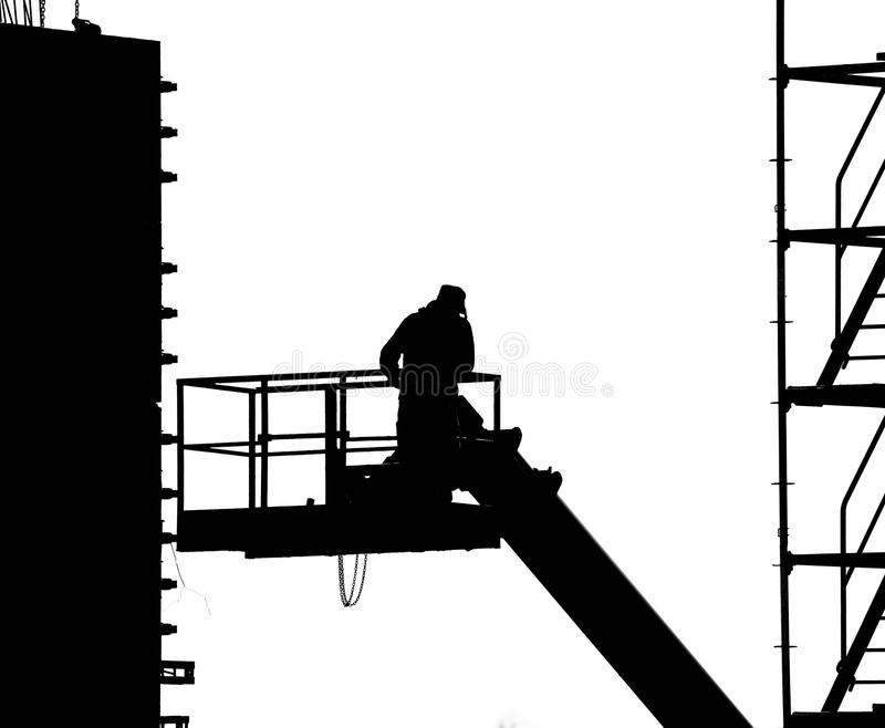 Worker pouring cement. Photograph of a worker pouring cement royalty free stock photography