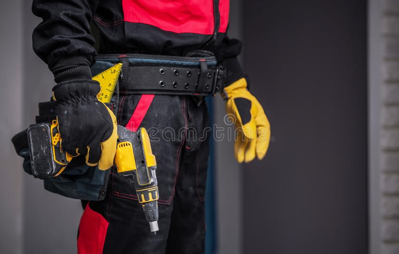 Worker with Power Tool. Preparing For Work. Closeup Photo. Construction Theme royalty free stock photo