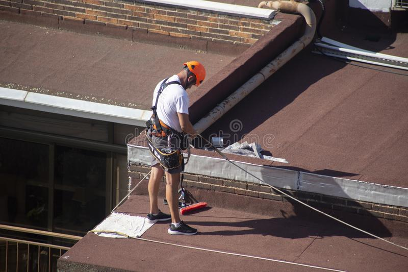 Madrid, Spain - September, 04, 2019: work at height. Worker with harness for dangerous work. A worker prepares with the helmet and harness to work at height from royalty free stock photo