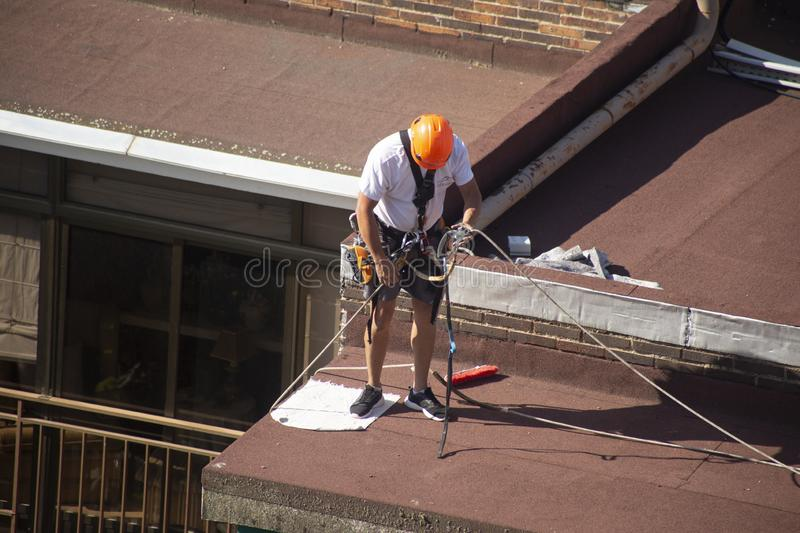 Madrid, Spain - September, 04, 2019: work at height. Worker with harness for dangerous work. A worker prepares with the helmet and harness to work at height from stock photos