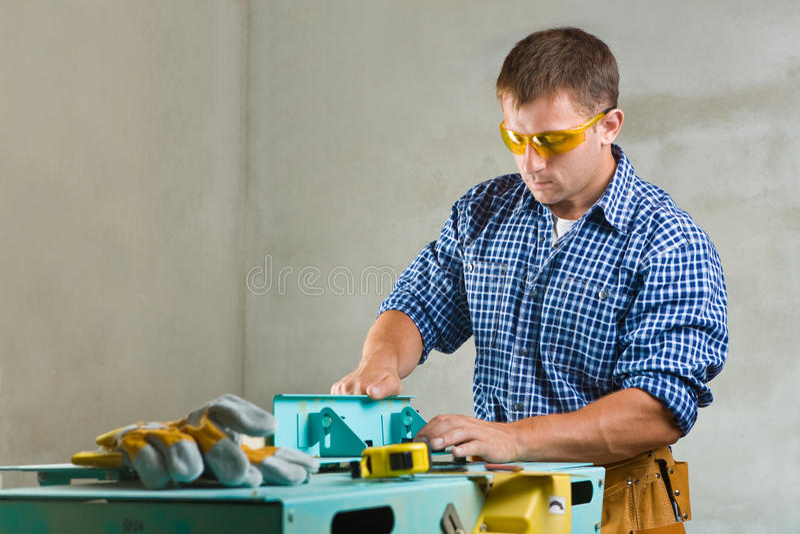 Worker prepares the woodworking mashine to work stock photos