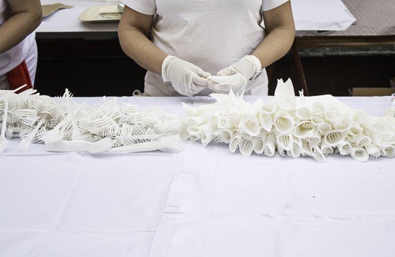 Worker preparing napkins. In celebration, food stock photo