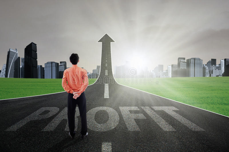 Worker on the profit highway. Businessman standing on the highway going up as an arrow with Profit text, symbolizing growth profit stock photos
